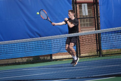 Kelton returning a serve.