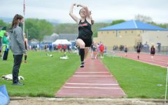 Chesney Saltsgiver jumping in the long jump
