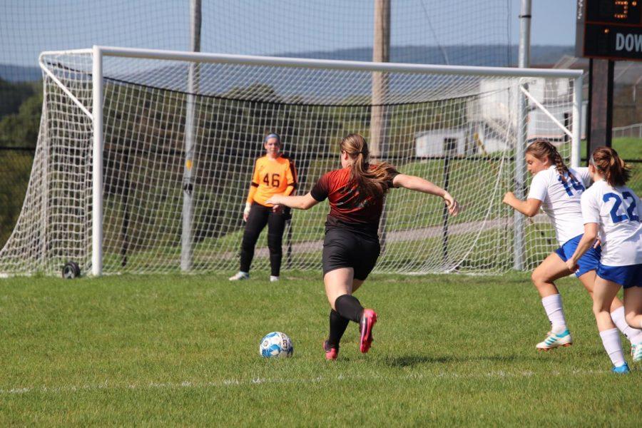Junior Alyson Partner taking a shot at goal.