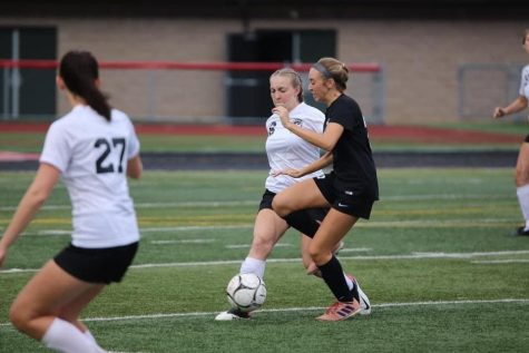 Senior Kenzie Latchford defending the ball from Clearfields player.