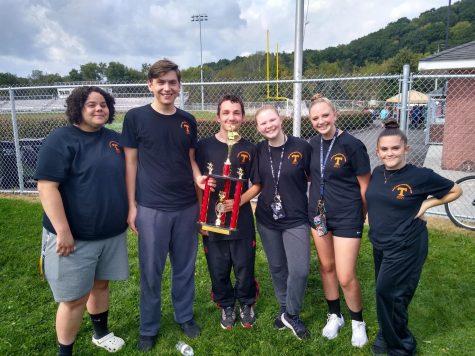Band seniors holding trophy