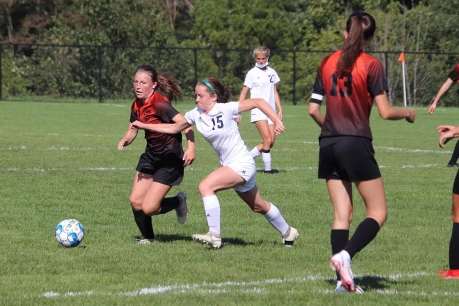 Sophomore Lainey Quick dribbling the ball up-field.