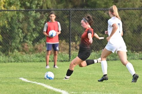 Junior Avalyn Moore preparing to shoot the ball at the goal.