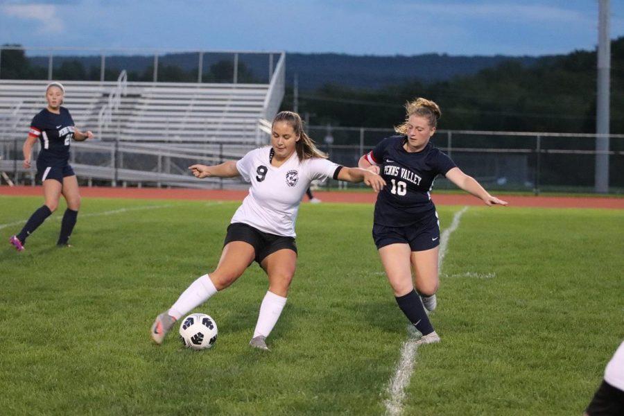 Junior Chloe LaRosa turning the ball towards the goal to shoot.