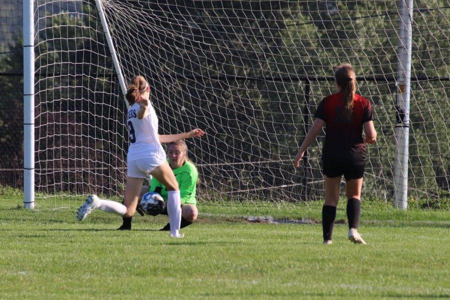 Junior goalkeeper Rayann Walls saving a goal.