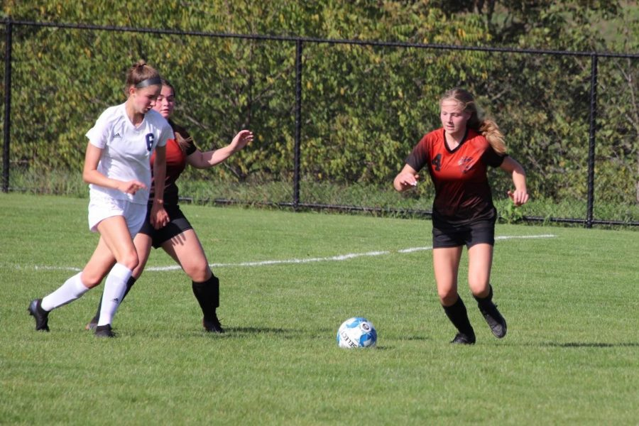 Sophomore Becca Lewis defending the ball from Hollidaysburg player.