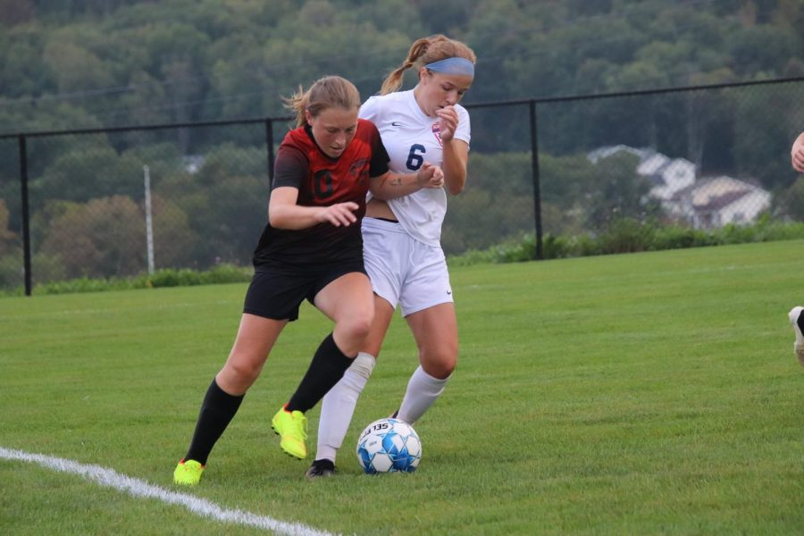 Sophomore Lainey Quick dribbling the ball past Huntingdon player.