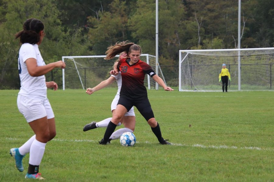 Senior Lindsey Parks defending the ball from the opposing player.