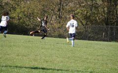 Freshman Evan Chichester shooting the ball