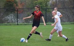 Senior Sophia Nelson looking to pass the ball up-field.