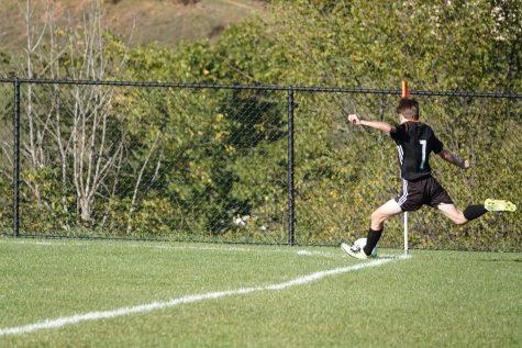 Conner Bardell taking a corner kick