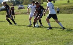 Sophomore Rocky Romani dribbling the ball through defenders