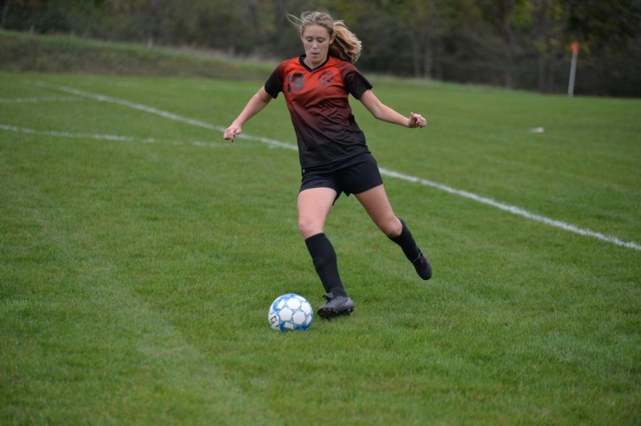 Senior Natalie Saltsgiver preparing to cross the ball to the left-side of the field.