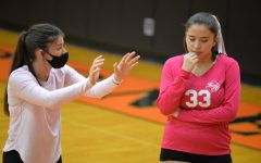 Moyer talks strategy with Tyrone sophomore middle hitter Aliza Yazzie.