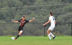 Freshman Evan Chichester making a long pass up the field