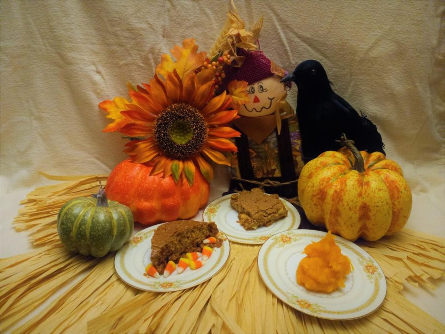 A triad of sweet treats is presented upon a backdrop of Halloween ordaments.