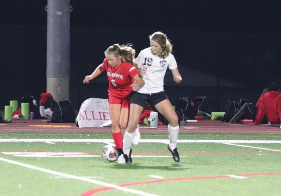 Senior Natalie Saltsgiver defending the ball from an opposing player.