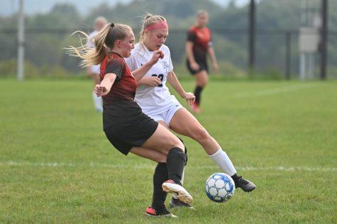Senior Mackenzie Latchford defending the ball against a Philipsburg-Osceola player. (file photo)