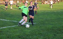 Keeper Rayann Walls kicking the ball out of play.