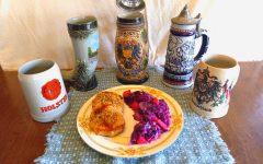 A plate of schnitzel and red cabbage backdropped by an adornment of german mugs.